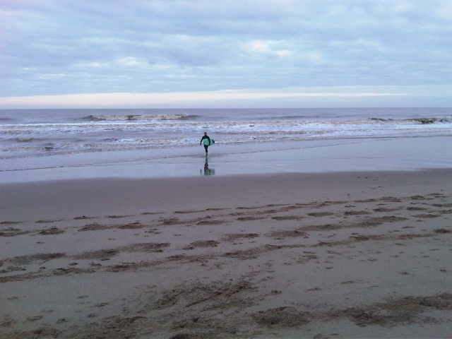 Surfer at Moggs Eye Beach, Lincolnshire